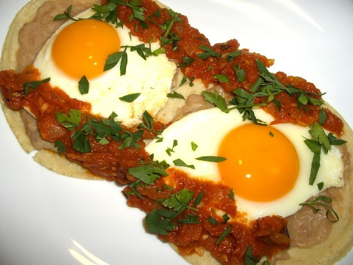 Photo Credit http://cookeatshare.com/recipes/huevos-rancheros-509309